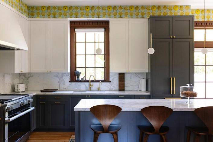 The kitchen is outfitted in Newport Brass fittings and walnut stools by the Cherner Chair Company.