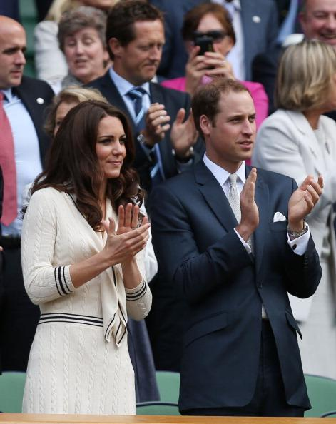 Catherine, Duchess of Cambridge and Prince William, Duke of Cambridge applaud from their seats in the Royal Box on Centre Court during day nine of the Wimbledon Lawn Tennis Championships at the All England Lawn Tennis and Croquet Club on July 4, 2012 in London, England. (Photo by Clive Rose/Getty Images)