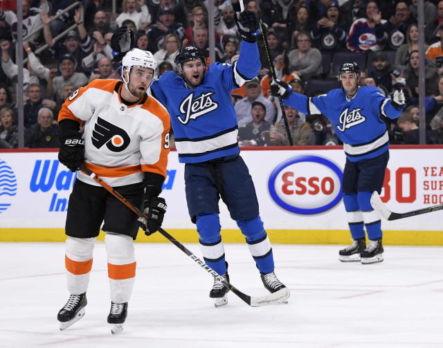 Winnipeg Jets' Logan Shaw (38) celebrates his goal as Philadelphia Flyers' Ivan Provorov (9) looks on during second-period NHL hockey game action in Winnipeg, Manitoba, Sunday, Dec. 15, 2019. (Fred Greenslade/The Canadian Press via AP)