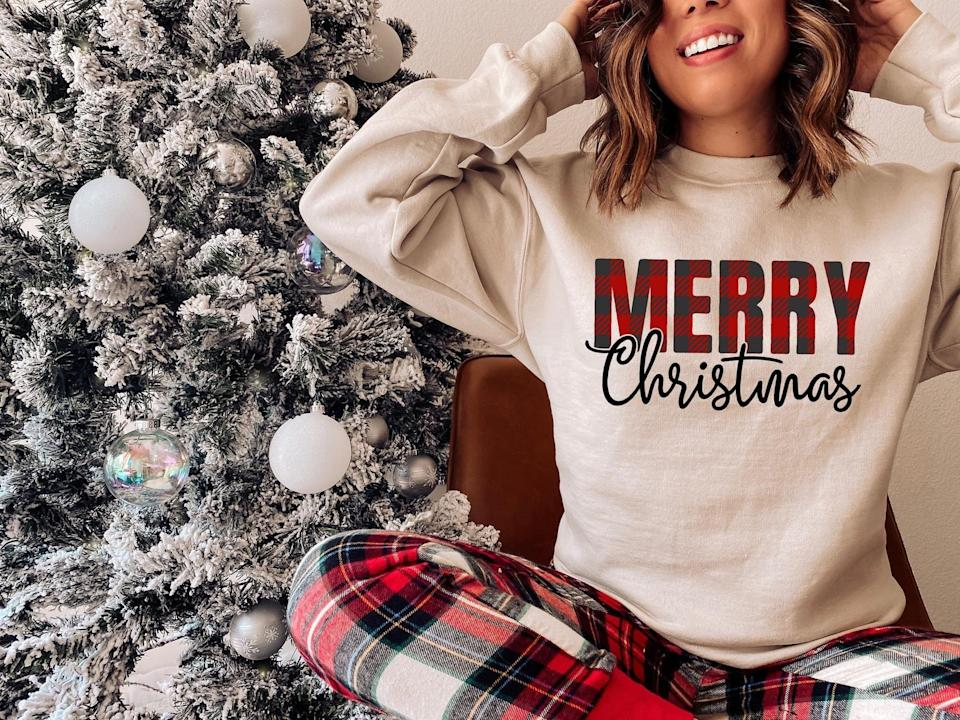 <p>We love the soft neutral color of this <span>Christmas Sweatshirt</span> ($23).</p>