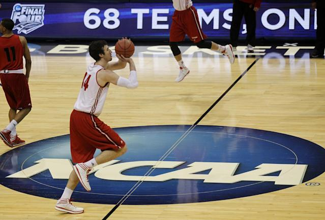 Wisconsin forward Frank Kaminsky takes a shot during a practice session for their NCAA college basketball tournament game Wednesday, March 19, 2014, in Milwaukee. Wisconsin plays American on Thursday, March 20, 2014. (AP Photo/Kiichiro Sato)