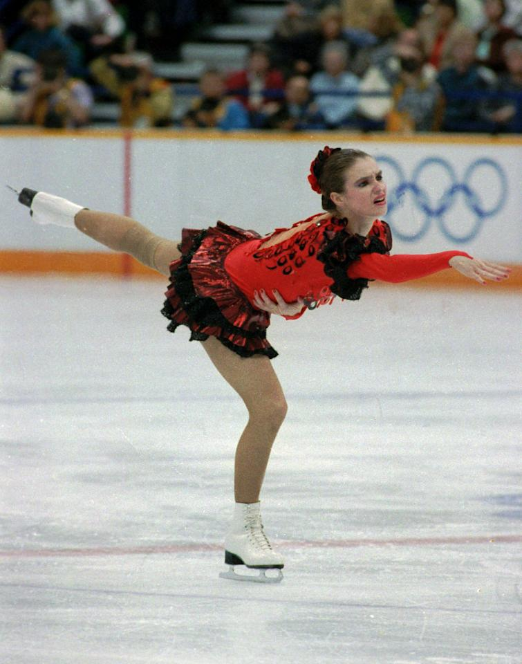 """Katarina Witt of East Germany in a seductive red and black dress dances to Bizet's """"Carmen"""" in her freestyle skating presenation at the Olympic women's figure skating competition at the Saddledome in Calgary night of Feb. 27,1988. Witt took the gold medal, defending her Olympic figure skating title with almost flawless dance. (AP Photo/stf)"""