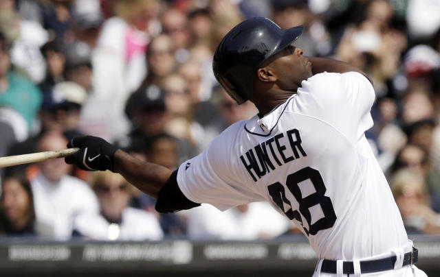 Detroit Tigers' Torii Hunter watches his solo home run off Baltimore Orioles starting pitcher Chris Tillman during the fourth inning of a baseball game in Detroit, Sunday, April 6, 2014. (AP Photo/Carlos Osorio)