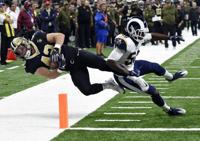 """Saints fullback Zach Line lunges for the end zone against Rams linebacker <a class=""""link rapid-noclick-resp"""" href=""""/nfl/players/29718/"""" data-ylk=""""slk:Cory Littleton"""">Cory Littleton</a> in a November game. (AP)"""