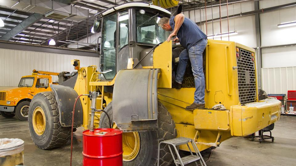 Heavy equipment requires a mechanic to climb on the machine to check oils, filters and make repairs.
