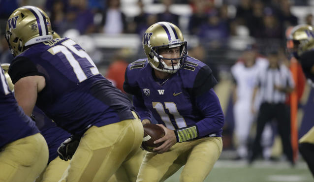"Washington quarterback <a class=""link rapid-noclick-resp"" href=""/ncaaf/players/244137/"" data-ylk=""slk:K.J. Carta-Samuels"">K.J. Carta-Samuels</a> in action against Fresno State in the second half of an NCAA college football game Saturday, Sept. 16, 2017, in Seattle. Washington won 48-16. (AP Photo/Elaine Thompson)"