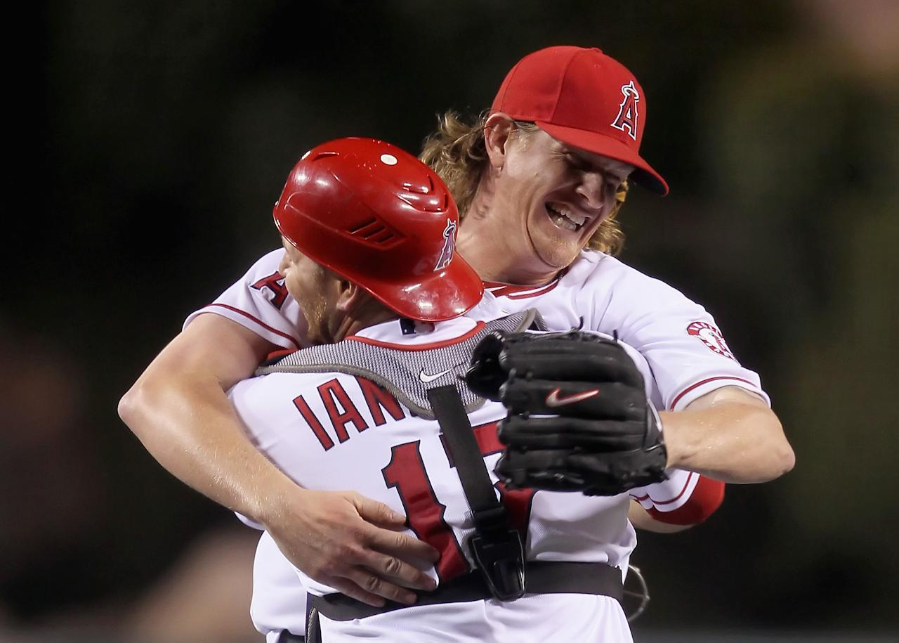 ANAHEIM, CA - MAY 02:  Starting pitcher Jered Weaver #36 of the Los Angeles Angels of Anaheim celebrates with catcher Chris Iannetta #17 after throwing a no-hitter against the Minnesota Twins at Angel Stadium of Anaheim on May 2, 2012 in Anaheim, California. The Angels defeated the Twins 9-0.  (Photo by Jeff Gross/Getty Images)
