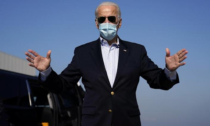 Joe Biden on the way to the final presidential debate at which he said his $2tn climate plan would create jobs.