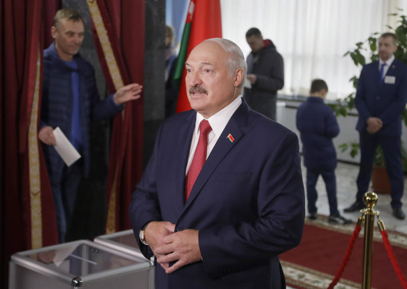 Belarusian President Alexander Lukashenko speaks to the media after voting at a polling station during parliamentary elections, in Minsk, Belarus, Sunday, Nov. 17, 2019. (AP Photo/Sergei Grits)