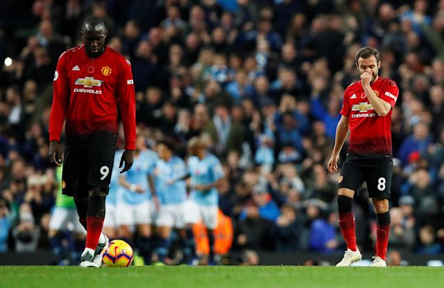 """Soccer Football - Premier League - Manchester City v Manchester United - Etihad Stadium, Manchester, Britain - November 11, 2018 Manchester United's Romelu Lukaku and Juan Mata look dejected after Manchester City's third goal Action Images via Reuters/Jason Cairnduff EDITORIAL USE ONLY. No use with unauthorized audio, video, data, fixture lists, club/league logos or """"live"""" services. Online in-match use limited to 75 images, no video emulation. No use in betting, games or single club/league/player publications. Please contact your account representative for further details."""