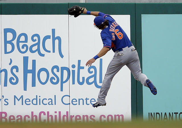 New York Mets' Matt den Dekker leaps to catch a fly ball hit by St. Louis Cardinals' Jon Jay in the fourth inning of an exhibition spring training baseball game, Sunday, March 16, 2014, in Jupiter, Fla. (AP Photo/David Goldman)