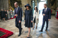 """FILE - In this Monday, March 12, 2018 file photo, from left, Britain's Prince William, Kate the Duchess of Cambridge, Meghan Markle and Britain's Prince Harry arrive for the Commonwealth Service at Westminster Abbey. Britain and its royal family are absorbing the tremors from a sensational television interview with Prince Harry and Meghan. The couple said they encountered racist attitudes and a lack of support that drove Meghan to thoughts of suicide. The couple gave a deeply unflattering depiction of life inside the royal household, depicting a cold, uncaring institution that they had to flee to save their lives. Meghan told Oprah Winfrey that at one point """"I just didn't want to be alive anymore."""" Meghan, who is biracial, said that when she was pregnant with son Archie, there were """"concerns and conversations about how dark his skin might be when he's born."""" (Paul Grover/Pool Photo via AP, FIle)"""