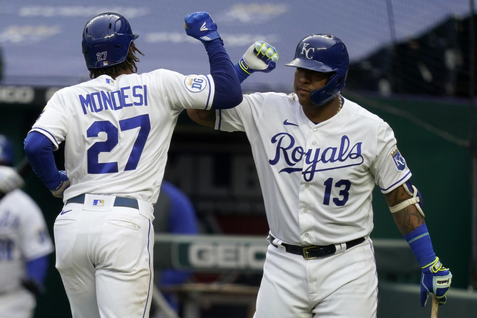 Kansas City Royals Adalberto Mondesi (27) is congratulated by teammate Salvador Perez (13) after his solo home run during the fourth inning of a baseball game against the Detroit Tigers at Kauffman Stadium in Kansas City, Mo., Sunday, Sept. 27, 2020. (AP Photo/Orlin Wagner)