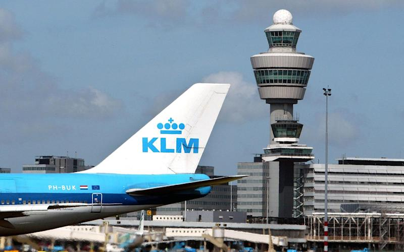 Non-EU lovers will soon be jetting into Amsterdam's Schiphol airport after months of separation from their Dutch partners.  - AFP