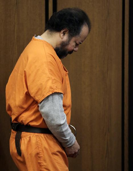 Ariel Castro walks into the courtroom Wednesday, July 24, 2013, in Cleveland. Attorneys for Castro, who is accused of holding three women captive in his home for more than a decade, have told a judge that plea negotiations in the case are still ongoing. Castro has pleaded not guilty to nearly 1,000 counts of kidnap, rape and other crimes. (AP Photo/Tony Dejak)