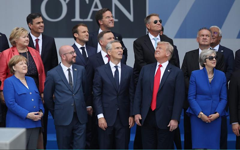 German Chancellor Angela Merkel, Belgian Prime Minister Charles Michel, NATO Secretary General Jens Stoltenberg, U.S. President Donald Trump and British Prime Minister Theresa May attend the opening ceremony at the 2018 NATO Summit at NATO headquarters on July 11, 2018 in Brussels