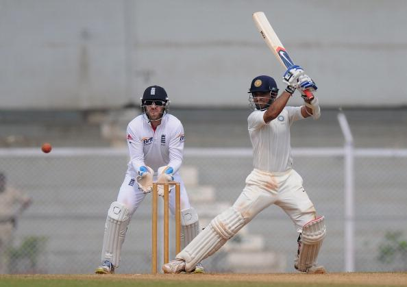 "MUMBAI, INDIA - NOVEMBER 01:  Ajinkya Rahane (R) of India 'A"" bats as Matt Prior of England looks on during the final day of the first practice match between England and India 'A' at the CCI (Cricket Club of India) ground, on November 1, 2012 in Mumbai, India.  (Photo by Pal Pillai/Getty Images)"