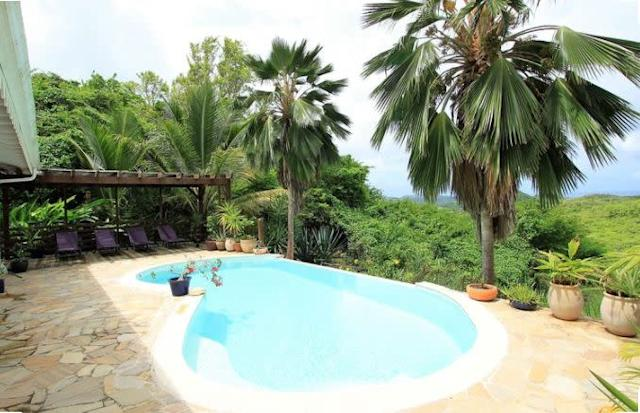 This three bedroom villa features a terrace, private pool with panoramic views of the sea and hills. The Creole-style villa includes everything you need for a comfortable stay, including laundry. <span>Check it out</span>.