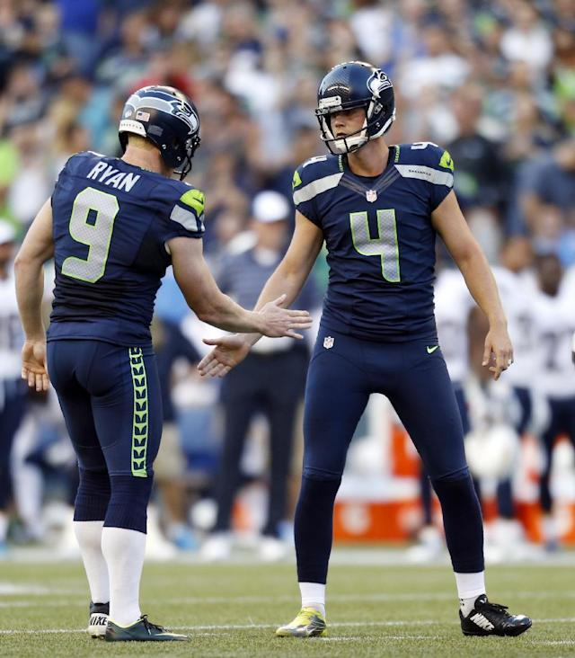 Seattle Seahawks kicker Steven Hauschka (4) is greeted by punter Jon Ryan (9) after Ryan held for a Hauschka field goal in the first half of a preseason NFL football game against the San Diego Chargers, Friday, Aug. 15, 2014, in Seattle. (AP Photo/John Froschauer)