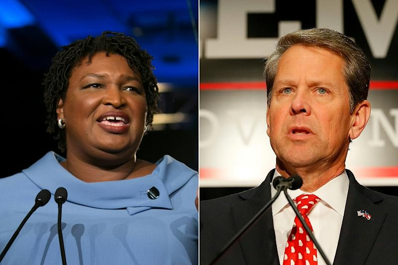 Stacey Abrams announced she will not win her bid to become the first black governor, but aimed fiery criticism at rival Brian Kemp (AFP Photo/Jessica McGowan, Kevin C. Cox)