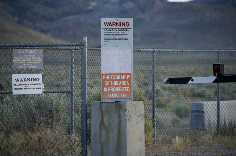 FILE - In this July 22, 2019, file photo, signs warn about trespassing at an entrance to the Nevada Test and Training Range near Area 51 outside of Rachel, Nev. Two men from the Netherlands who said they wanted to post internet video of the once-secret Area 51 military base in Nevada were arrested on suspicion of trespassing onto a secure U.S. government reservation, sheriff's officials said Thursday, Sept. 12, 2019. (AP Photo/John Locher, File)