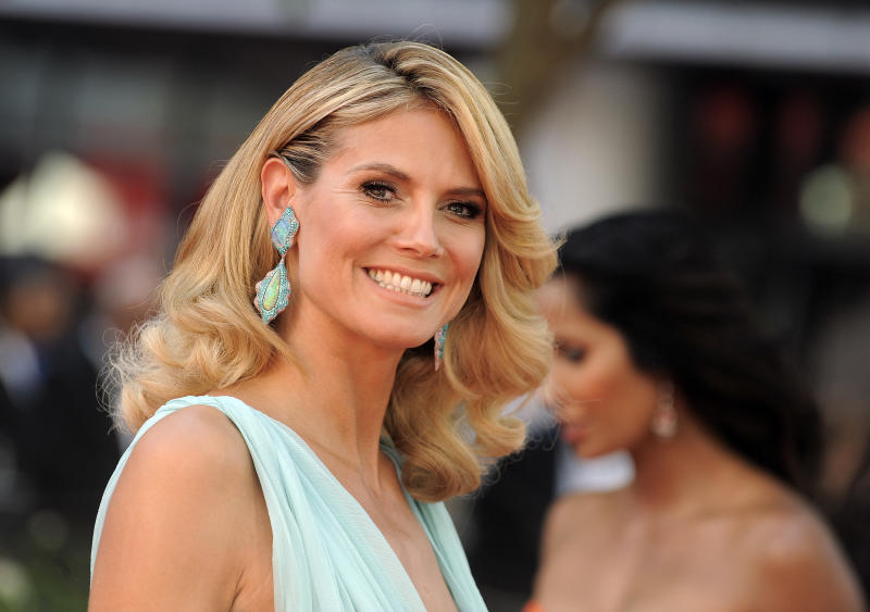 """FILE - This Sept. 23, 2012 file photo shows model and host of """"Project Runway,"""" Heidi Klum arriving at the 64th Primetime Emmy Awards at the Nokia Theatre in Los Angeles. Sunday's Emmy Awards opened the first big fashion red-carpet of the season _ and it was a long runway: a parade of rainbow-bright gowns, skyscraper heels, glittering clutches that only hold a lipstick, along with millions of dollars in jewels. (Photo by Jordan Strauss/Invision/AP, file)"""