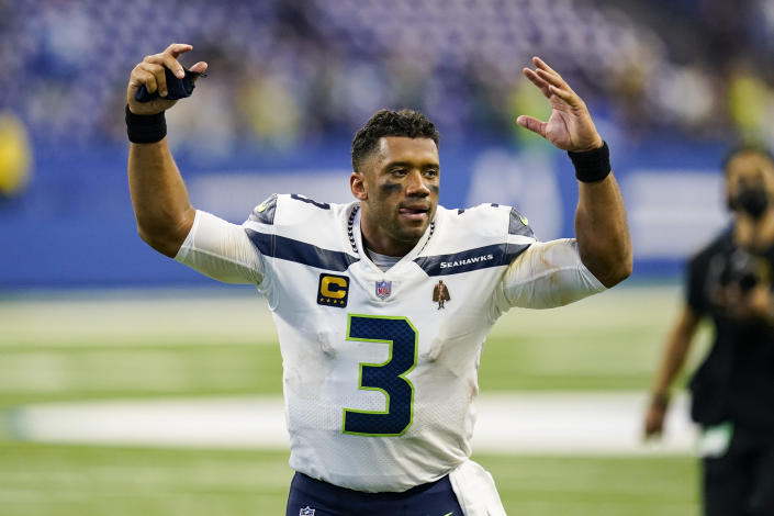 Seattle Seahawks quarterback Russell Wilson (3) waves to fans as he leaves the field following a 28-16 win over the Indianapolis Colts in an NFL football game in Indianapolis, Sunday, Sept. 12, 2021. (AP Photo/Charlie Neibergall)