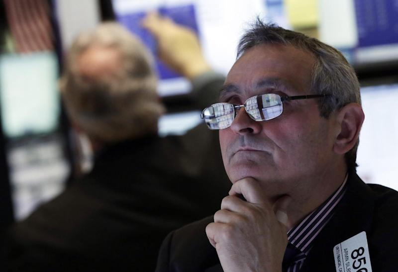 In this Wednesday, Jan. 23, 2013 photo, the screens of specialist Armin Silbersmith are reflected in his glasses as he works at his post on the floor of the New York Stock Exchange. Europe's stock markets were broadly higher Thursday Jan. 23, 2013 amid signs the continent's services and manufacturing slump was easing.  (AP Photo/Richard Drew)