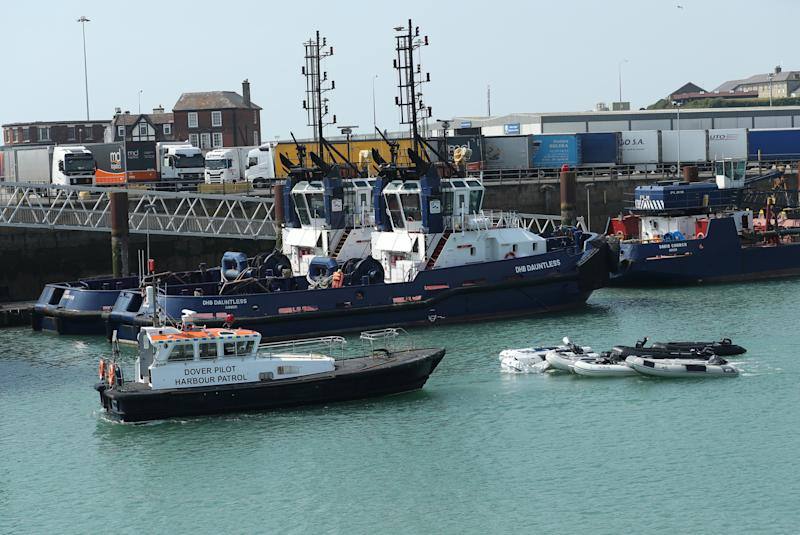 A Dover Pilot Harbour Patrol boat taking dingys out to sea.