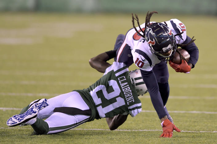 Houston Texans wide receiver DeAndre Hopkins (10) is tackled by New York Jets cornerback Morris Claiborne (21) during the second half of an NFL football game, Saturday, Dec. 15, 2018, in East Rutherford, N.J. (AP Photo/Bill Kostroun)