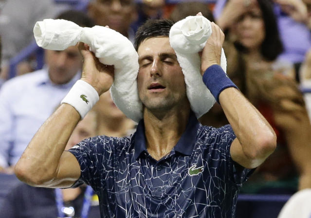 Novak Djokovic, of Serbia, sits during the changeover in a quarterfinal against John Millman, of Australia, of the U.S. Open tennis tournament Wednesday, Sept. 5, 2018, in New York. (AP Photo/Frank Franklin II)