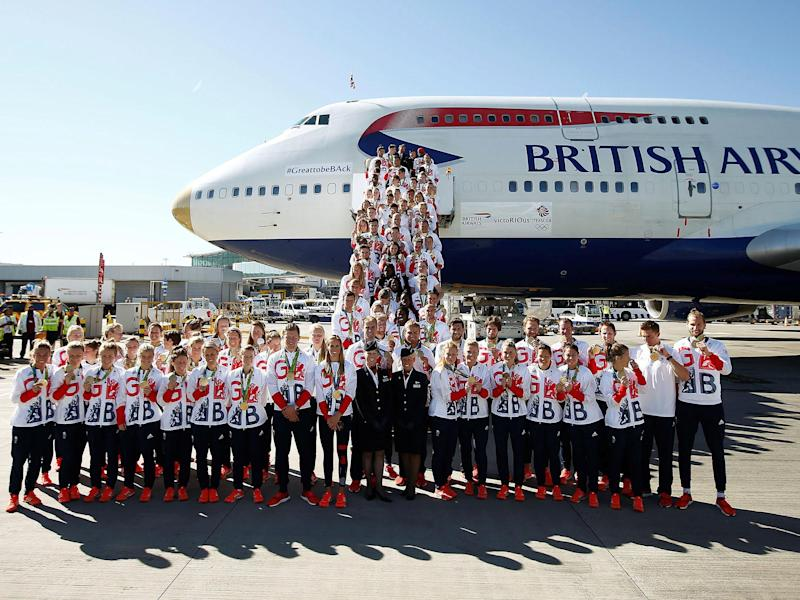 Team GB athletes pose for a photograph as they return home from the 2016 Rio Olympics, at Heathrow Airport in London: Reuters