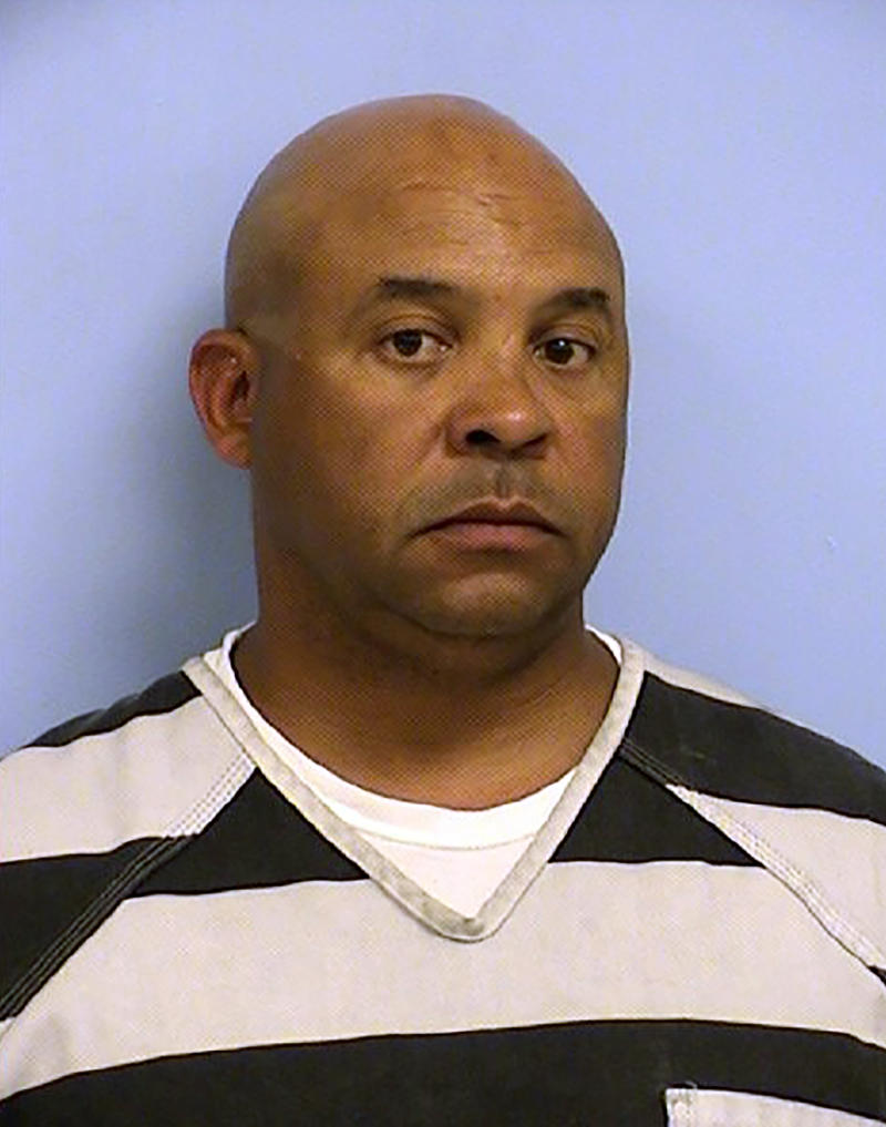 This undated photo provided by the Austin Police Department shows John Jones. The Texas Department of Public Safety says Jones, its chief of intelligence and counterterrorism, has been accused of raping a woman who attended a party at his house. The agency says Jones was arrested on a sexual assault charge and fired Tuesday, July 30, 2019. He remained in jail Wednesday, with bail set at $750,000. (Austin Police Department via AP)