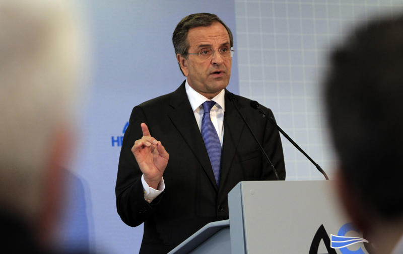 Greek Prime Minister Antonis Samaras, delivers a speech during the inauguration of the annual Thessaloniki International Trade Fair Saturday Sept. 7, 2013. Labor unions are planing a series of weekend demonstrations in the country's second largest city, demanding a reversal of minimum wage cuts imposed in the bailed out country last year. His government is facing confrontation with unions over plans to begin mass firings and forced transfers of public sector workers. (AP Photo/Nikolas Giakoumidis)