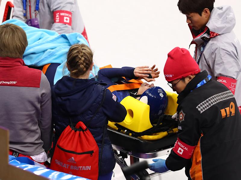 Elise Christie was stretchered out of the arena: Getty