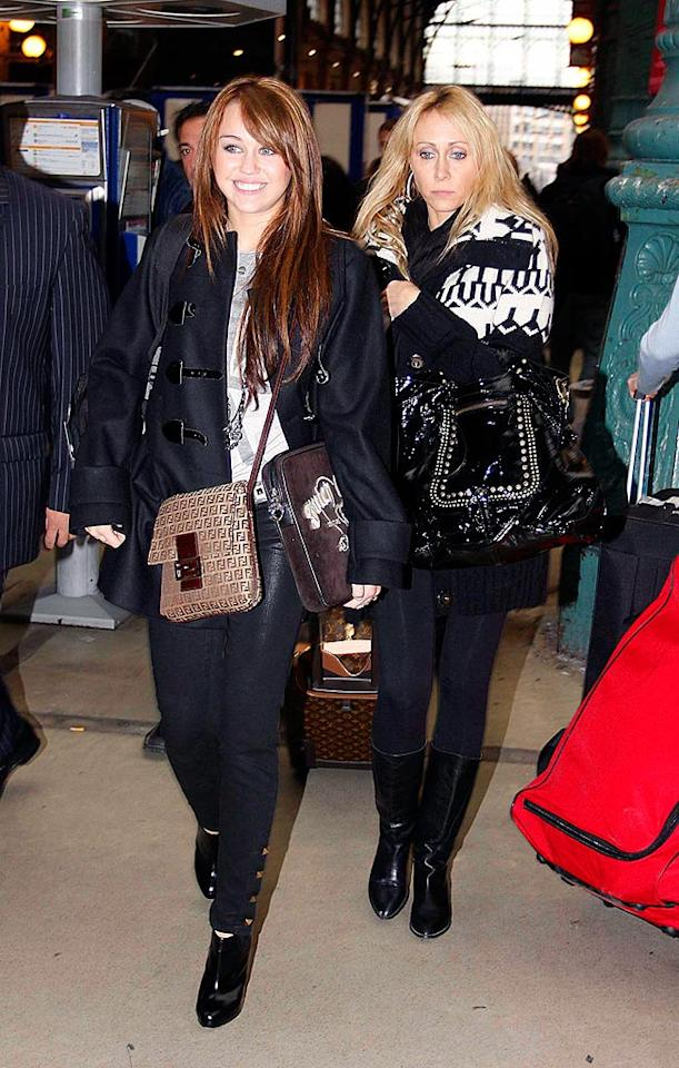 """A chic Miley Cyrus was spotted in Paris with her mom on Thursday. The 15-year-old dispelled rumors that she's leaving """"Hannah Montana,"""" telling """"Extra"""" that """"as much as it's really hard work, [the TV show's] really great."""" KCSPresse/<a href=""""http://www.splashnewsonline.com"""" target=""""new"""">Splash News</a> - October 30, 2008"""