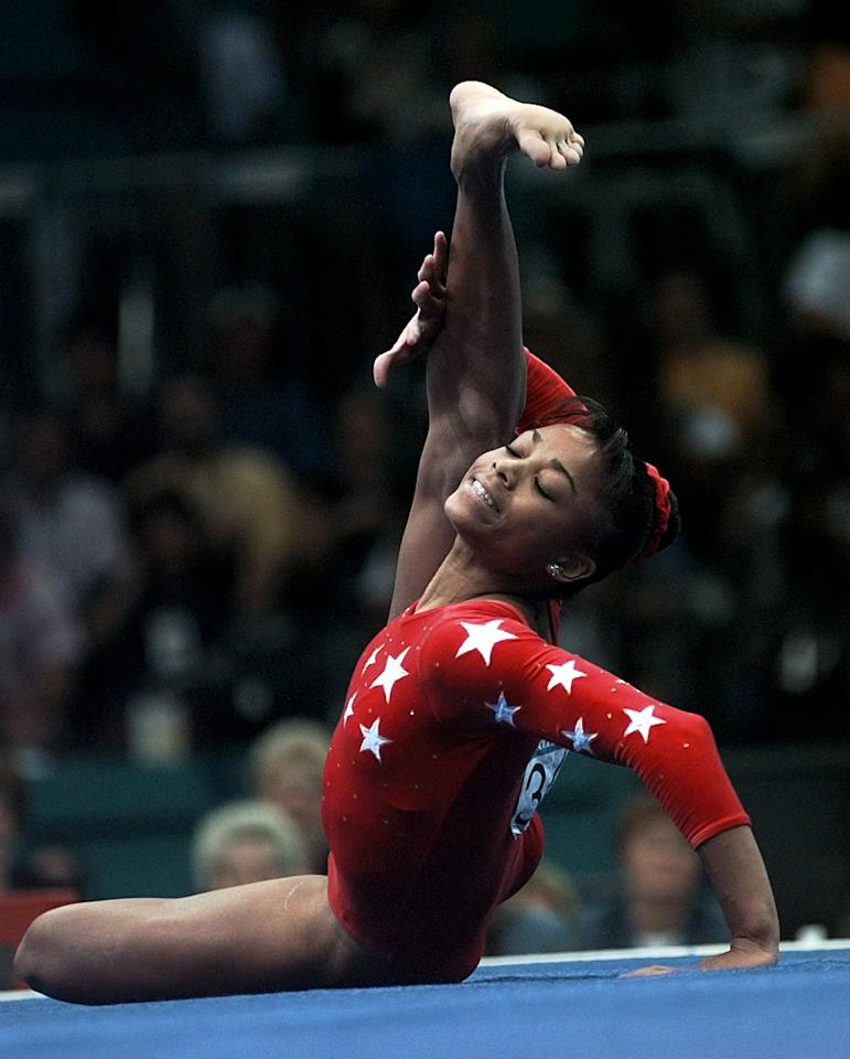 Dominique Dawes of the United States performs her floor exercises routine during the women's individual event gymnastics finals of the Centennial Summer Olympic Games in Atlanta Monday, July 29, 1996.  Dawes won the bronze medal. (AP Photo/Ed Reinke)