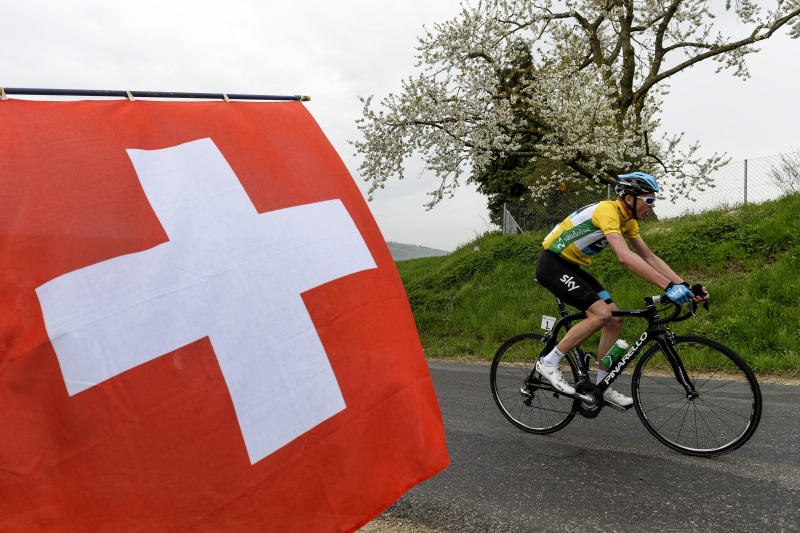 FILE - In this Friday, April 26, 2013 file photo, overall leader Chris Froome of Britain rides past a Swiss national flag during the 181 kilometer (112 mile) third stage from Payerne to Payerne at the 67th Tour de Romandie UCI ProTour cycling race near Sassel, Switzerland. Froome said Tuesday, March 4, 2014 that he wants an investigation into cycling's doping history to finally close an era dominated by Lance Armstrong. (AP Photo/Keystone, Jean-Christophe Bott, File)