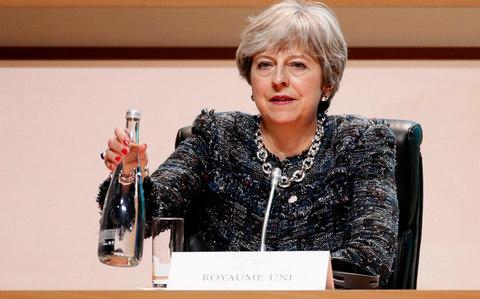 Theresa May attends the plenary session of One Planet Summit, in Boulogne - Credit: Etienne Laurent/EPA