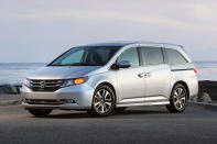 This undated photo provided by American Honda Motor Co. shows the 2016 Honda Odyssey. Some notable features in higher trims of the vehicle are Xenon headlights, a blind-spot warning system, an integrated vacuum cleaner, and a rear-seat entertainment system. (American Honda Motor Co. via AP)