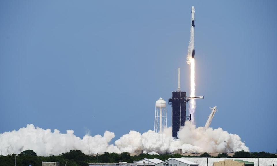 A SpaceX Falcon 9, with Nasa astronauts Doug Hurley and Bob Behnken in the Dragon crew capsule, lifts off from Cape Canaveral