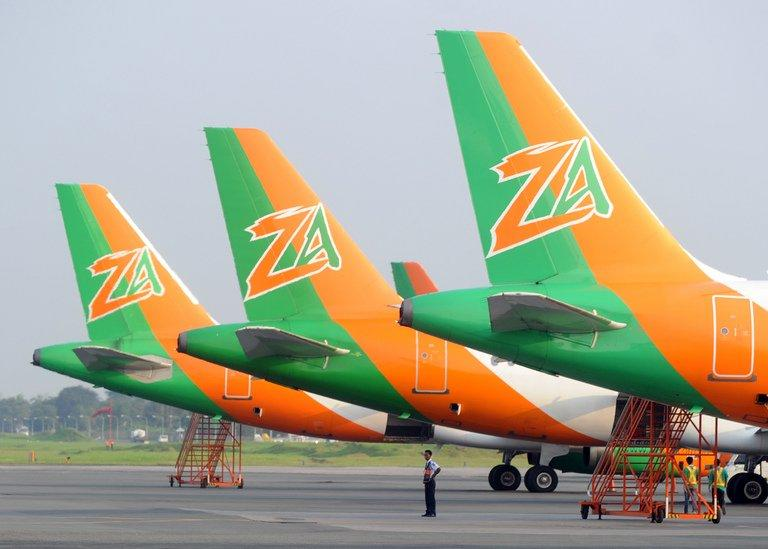 Security personnel stands next to the planes of budget carrier Zest Air at the international airport in Manila