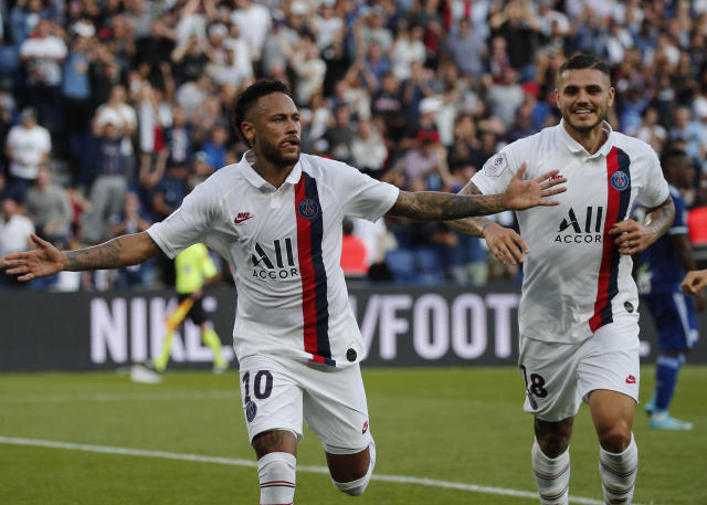 PSG's Neymar, left, celebrates his goal with PSG's Mauro Icardi during the French League One soccer match between Paris Saint Germain and Strasbourg at the Parc des Princes Stadium in Paris, France, Saturday Sept.14, 2019. (AP Photo/Francois Mori)