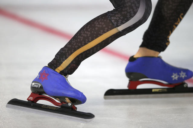 The decorated skates of Miho Takagi of Japan are seen as she assumes the start position during the women's 1,500 meters race at the World Championships Speedskating Allround at the Olympic stadium in Amsterdam, Netherlands, Saturday, March 10, 2018. (AP Photo/Peter Dejong)