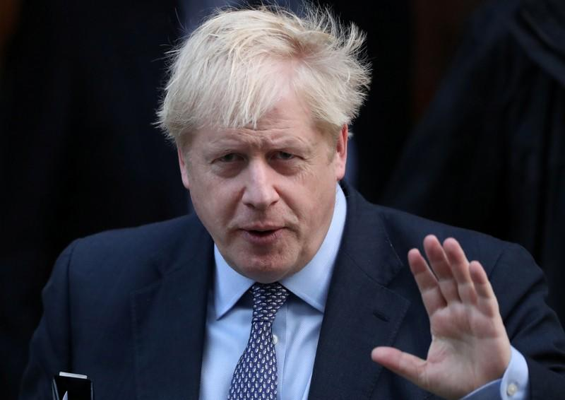 Britain's Prime Minister Boris Johnson leaves Downing Street to head for the House of Commons as parliament discusses Brexit, sitting on a Saturday for the first time since the 1982 Falklands War, in London