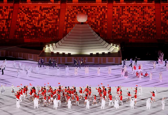 <p>TOKYO, JAPAN - JULY 23: Flag bearers Ting Zhu and Shuai Zhao of Team China lead their team out during the Opening Ceremony of the Tokyo 2020 Olympic Games at Olympic Stadium on July 23, 2021 in Tokyo, Japan. (Photo by Laurence Griffiths/Getty Images)</p>