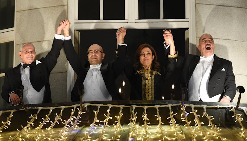 The Nobel Peace Prize laureates of the Tunisian National Dialogue Quartet appear on the balcony of the Grand Hotel in Oslo to greet well wishers on December 10, 2015 (AFP Photo/Odd Andersen)