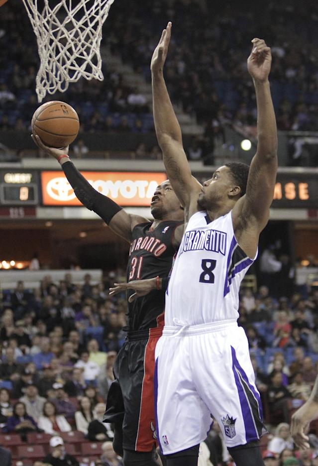 Toronto Raptors forward Terrence Ross, left, drives to the basket against Sacramento Kings forward Rudy Gay during the first quarter of an NBA basketball game in Sacramento, Calif., Wednesday, Feb. 5, 2014. (AP Photo/Rich Pedroncelli)