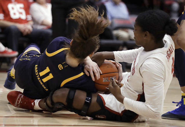 California guard Sara Anastasieska (11) fights for the ball with Stanford's Nadia Fingall, right, during the first half of an NCAA college basketball game Friday, Jan. 10, 2020, in Stanford, Calif. (AP Photo/Ben Margot)