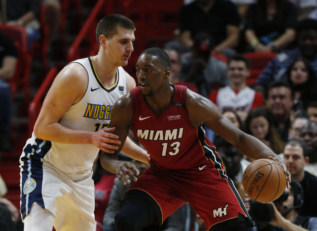 Miami Heat center Bam Adebayo (13) drives against Denver Nuggets center Nikola Jokic (15) during the first half of an NBA basketball game, Monday, March 19, 2018, in Miami. (AP Photo/Wilfredo Lee)